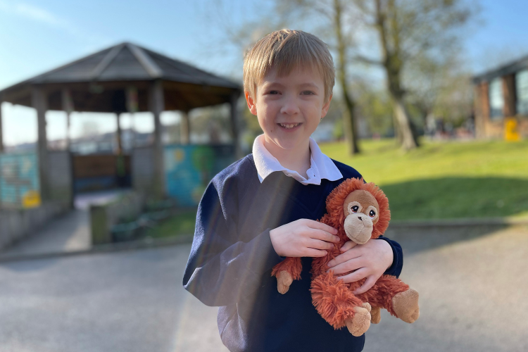 Gabe with his monkey about to go into school