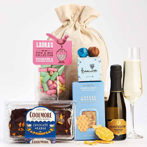 Sweets and biscuits in front of a plain fabric bag
