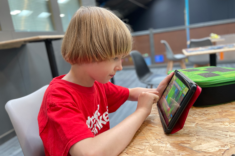 Toby playing on his tablet at Street Monkeys