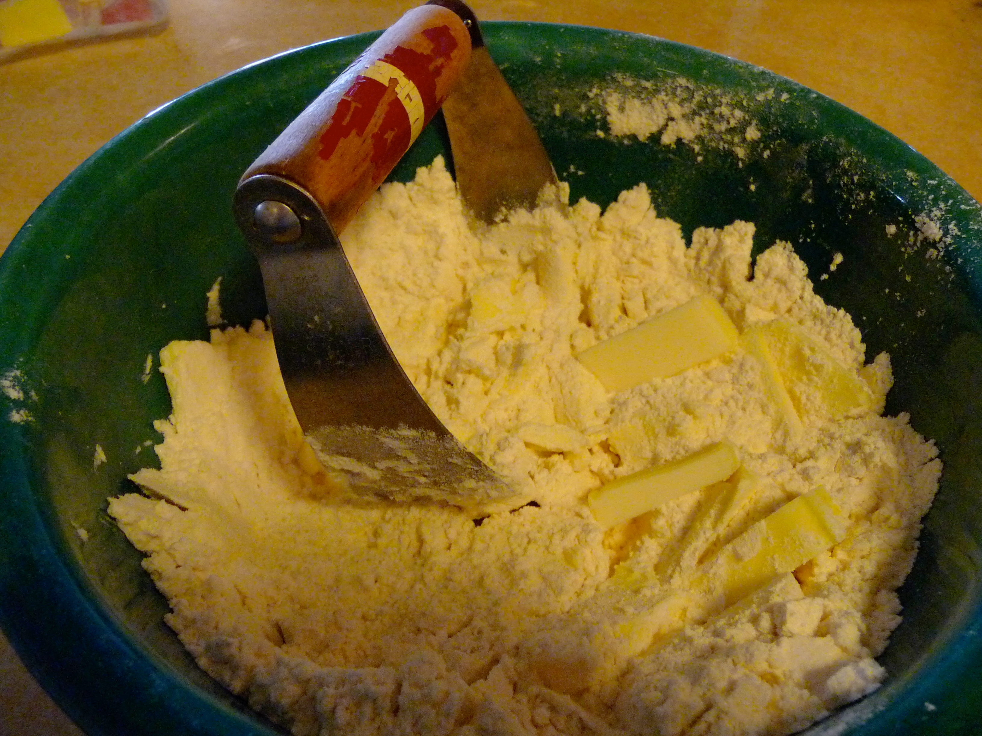 You can use a pastry cutter or your fingers to cut the butter into the flour