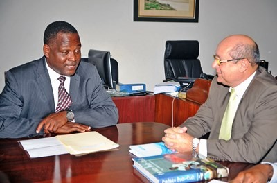 Industry Minister, Donville Inniss and Cuban Ambassador, Francisco Fernandez Pena in discussion during their meeting at the Reef Road today. (Photo via A.Miller/BGIS)