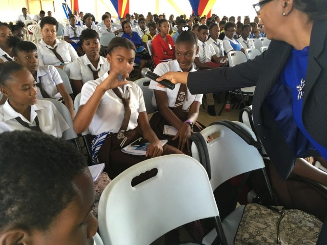 Jamaica's CSME Focal Point, Ms. Symone Betton-Nayo interacts with students