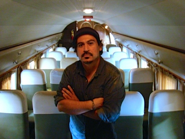 Tim Hernandez stands in an exact replica of the Douglas DC-3 that was involved in the 1948 place crash.