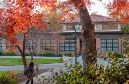 Student walks across campus