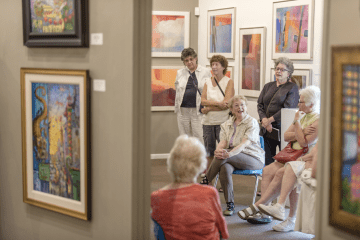 Professor Emeritus Dolores Mitchell (center) leads an Arts and Eats Class class for fellow OLLI members at the Chico Art Center