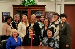 President Hutchinson and 10 of the 12 CSU women presidents sit around Dianne Feinstein at a conference table.