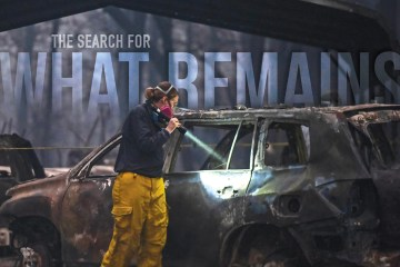 "Karin Wells shines a flashlight into a burnt vehicle enshrouded in darkness from smoke with the text ""The Search for What Remains"" imposed bove"