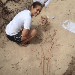 Students in the process of excavating a skeleton.
