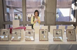 Department of Chemistry and Biochemistry Professor Monica So looks at a display of faculty publications during Inspired '17, the University's inaugural celebration of publication achievements of faculty, staff, and personnel.