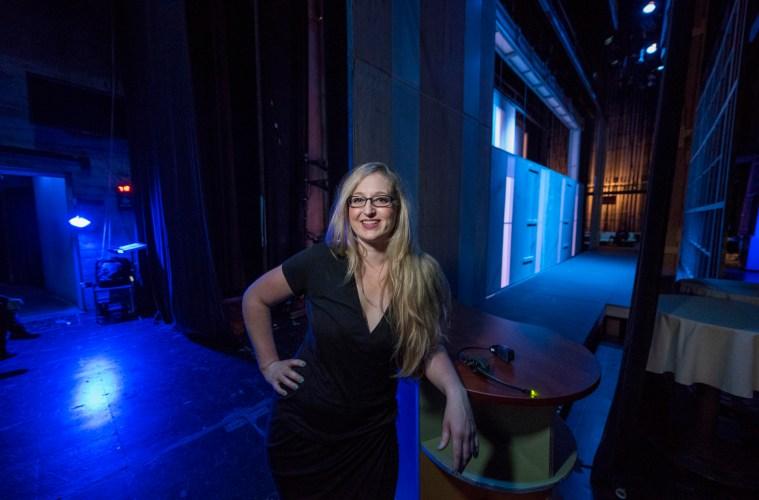 Lara Tenckhoff smiles backstage of Laxson Auditorium.