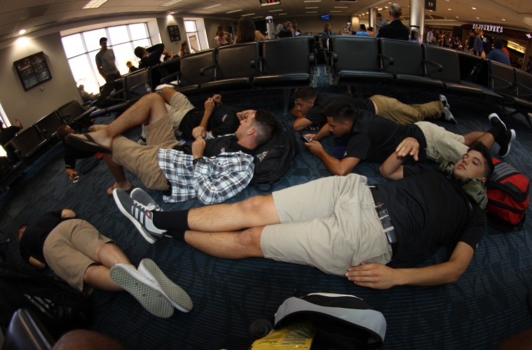 Members of the Chico State men's soccer team relax during a layover at Hartsfield-Jackson Atlanta International Airport, on their way to Spain. (Photo by Dylan Wakefield/Men's Soccer)