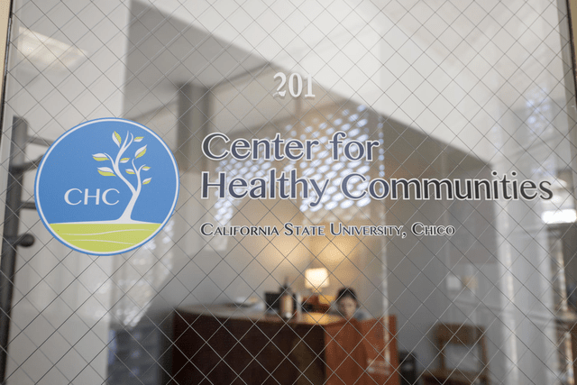 "A glass door reads ""Center for Healthy Communities."""