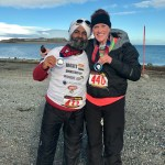 Vanden Bosch and a friend hold up their medals on a rocky beach