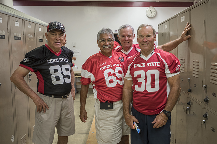 Wildcat football alumni pose in Chico State jerseys