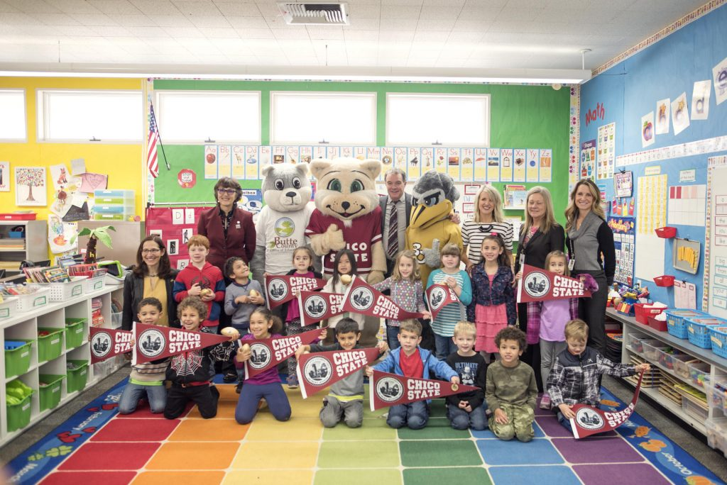 Kindergartner class poses with education officials and mascots from Butte College and Chico State