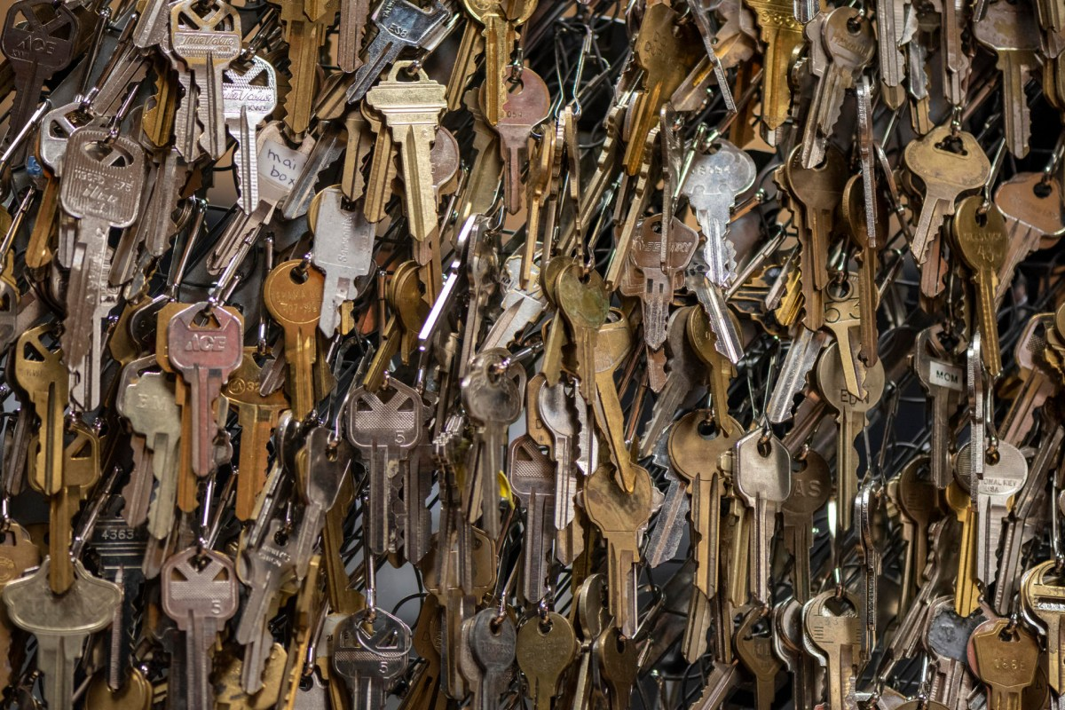 Hundreds of keys hang with clips.