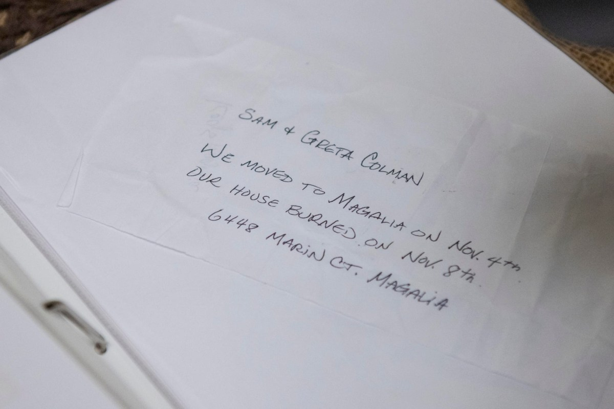 """A hand-written note in a photo album says """"We moved to Magalia on Nov. 4th. Our house burned on Nov. 8."""""""