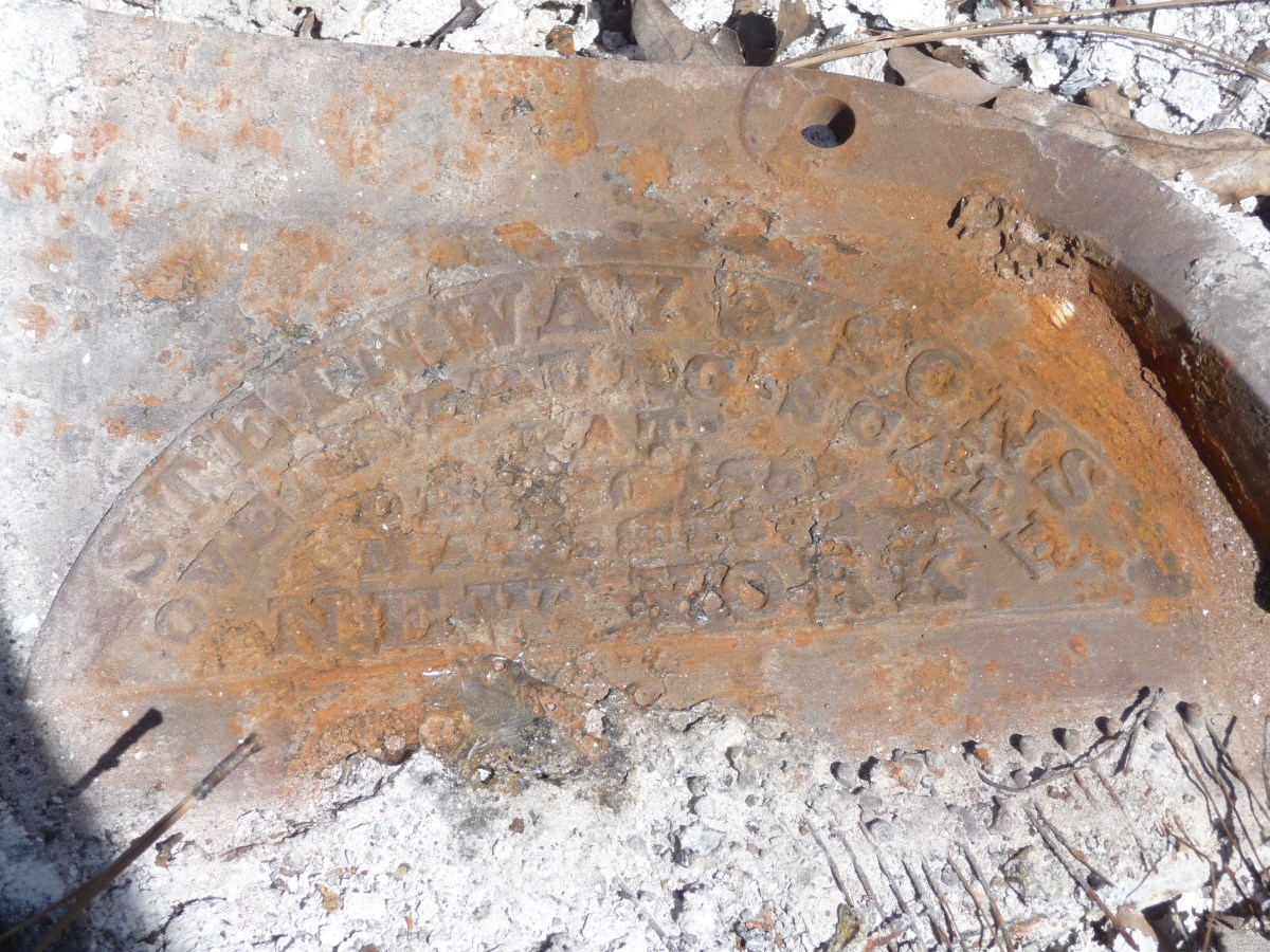 The rusted fire-scorched patent of the piano.