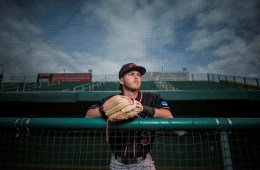 Cameron Santos poses with his baseball mitt.