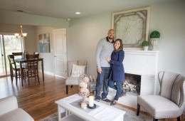 David and Chenoa Rivera stand in the living room of a recently flipped home.