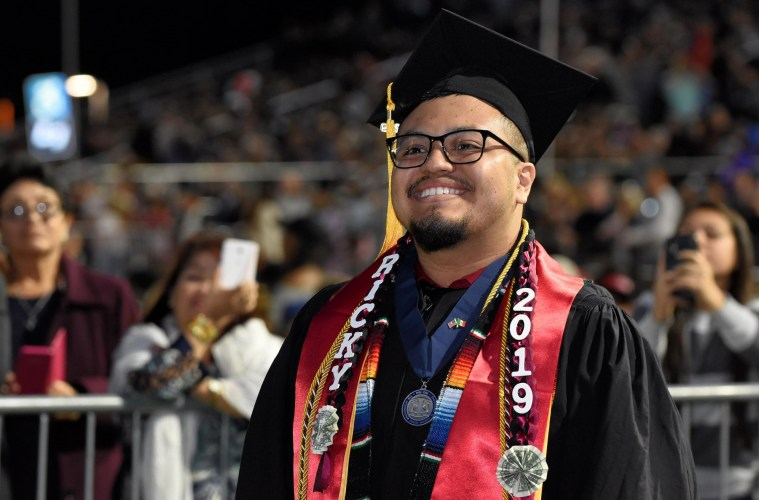 Enrique Galvan poses at the 2019 Commencement ceremony