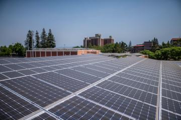 "Solar panels are arrayed atop of Yolo Hall (in front) and Acker Gym (center) with Whitney Hall in the background on the Chico State campus. Chico State was recently recognized for an overall commitment to sustainable practices in the Association for the Advancement of Sustainability in Higher Education's its 2018 Sustainability Campus Index. Additionally, Sierra Club placed CSU, Chico at No. 9 in its ""Cool Schools 2018"" list, the highest ranking of any CSU institution, and the first top-10 overall sustainability ranking nationwide for the University."