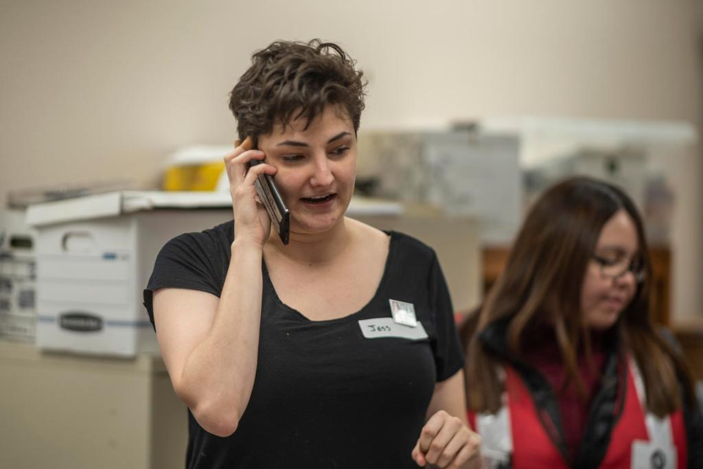 Jessica Anthony talks on the phone in the calling center.