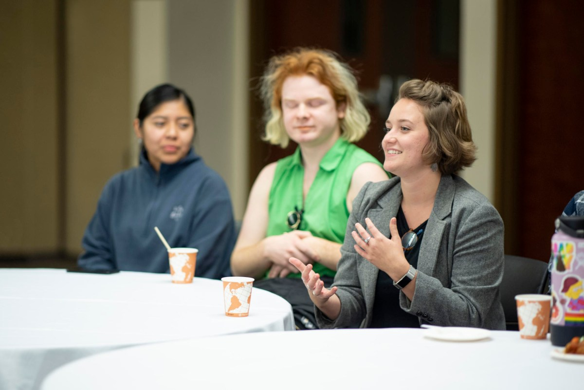 Alix MacDonald asks a question of a speaker at a group gathering.