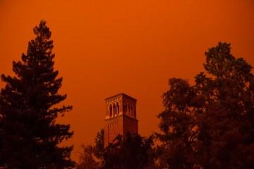 Trinity Hall amid a glowing orange sky.