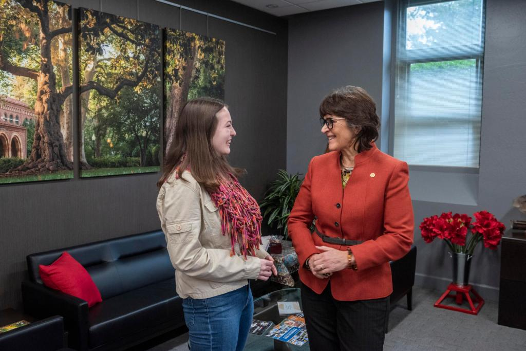 Student Emily Zarback smiles with Chico State President Gayle Hutchinson.