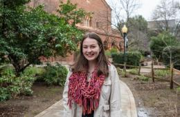 First-year pre-nursing student Emily Zarback smiles while standing with Kendall Hall in the background.