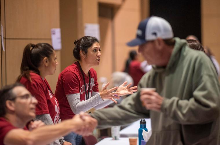Chico State employees help answer questions of their colleagues during a Camp Fire resource fair.