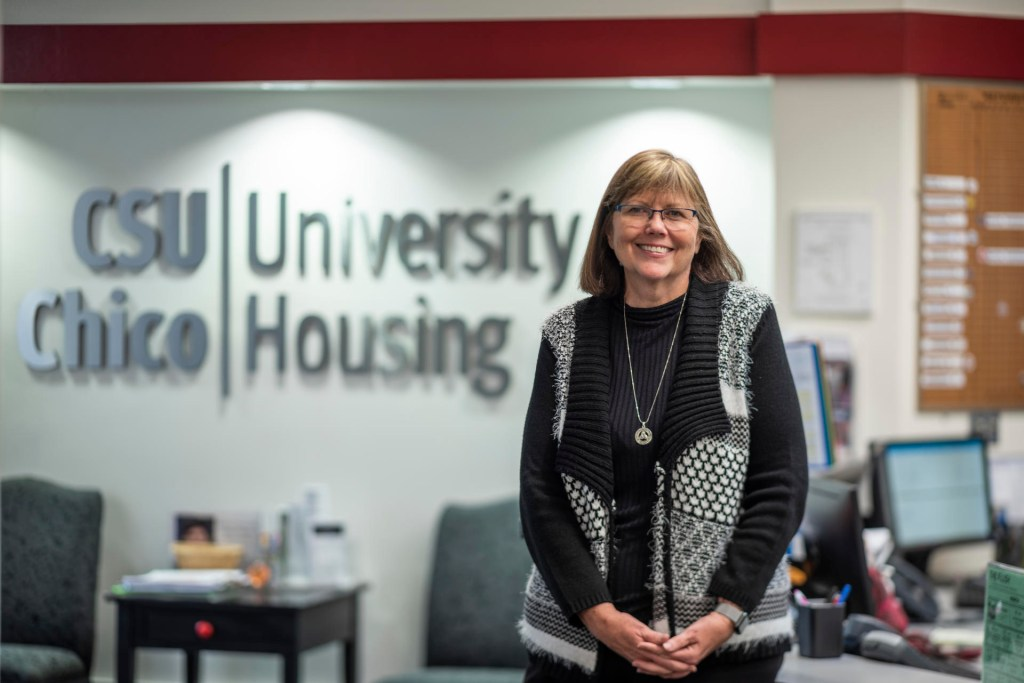 Connie Huyck stands in Chico State's office of Student Housing.