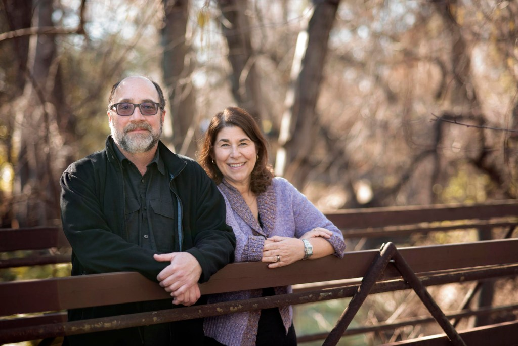 Photo of Joe Picard (left) and Diana Dwyer (right) standing on a campus bridge.