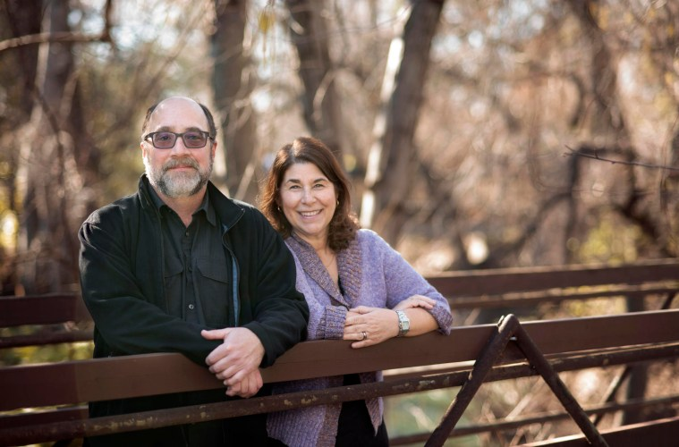 Campus couples Diana Dwyer (left) and Joe Picard (right) smile on a bridge by the creek on Monday, January 30, 2017 in Chico, Calif. (Jessica Bartlett/Student Photographer)