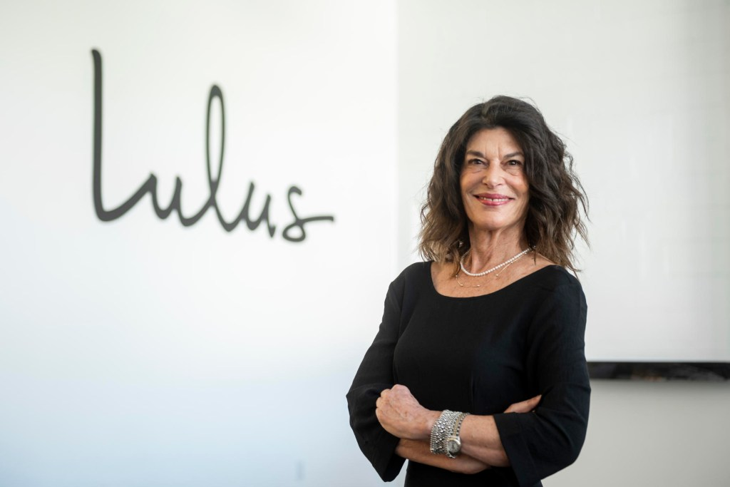 Portrait of Debra Cannon with the Lulus logo behind her.