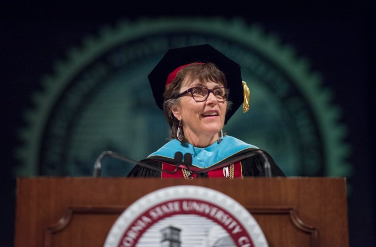 Chico State President Gayle Hutchinson speaks from a podium during a graduate student ceremony.