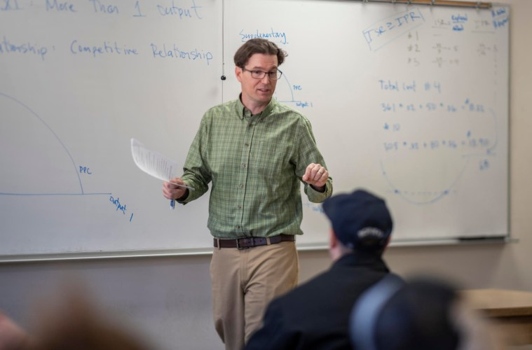 Professor Eric Houk teaches students in his class.