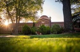 The sun sets behind Kendall Hall.