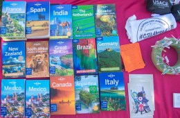 Books highlighting different countries around the world are on a table.