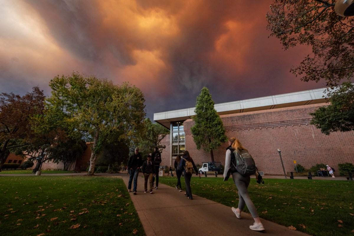Dark orange and black ominous skies cascade over campus.