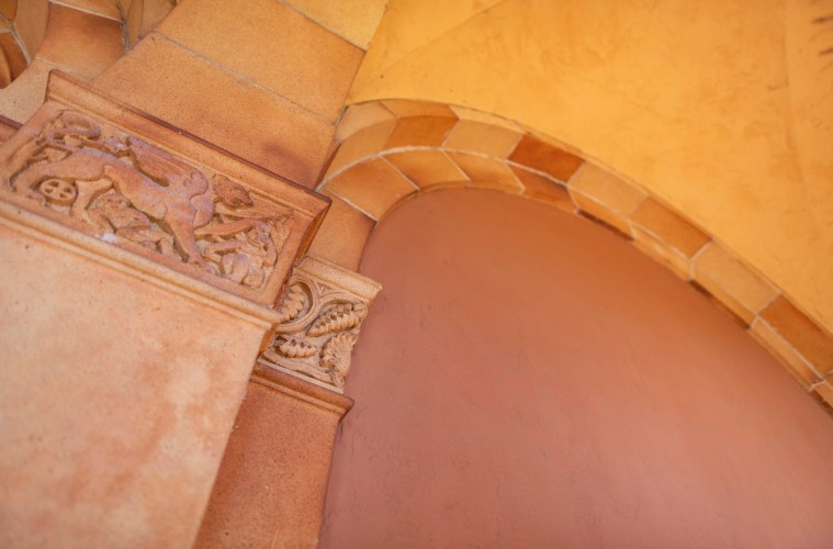 A close up of arches in front of a building.