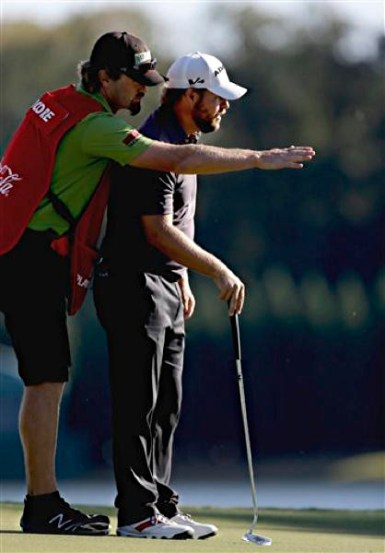 Ryan Moore, right, and caddie J.J. Jakovac  during the final round in the Tour Championship golf tournament in 2012 in Atlanta.