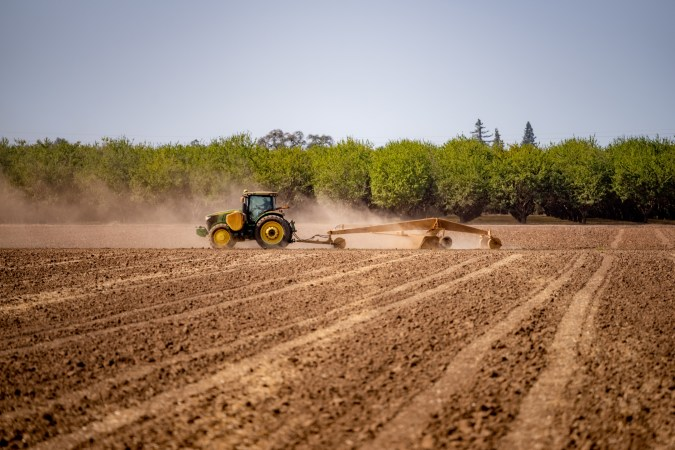 A tractor readies the fields at the University Farm