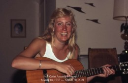 Karin Hoover plays a guitar.