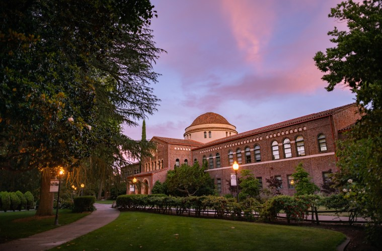 Kendall Hall is framed in the light of a sunset.
