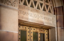 """""""Today Decides Tomorrow"""" is read on the Kendall Hall building"""