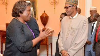 Assistant Secretary of State for African Affairs Linda Thomas-Greenfield greets Nigerian President Muhammadu Buhari before U.S. Secretary of State John Kerry hosted a working lunch for the President and his delegation at the U.S. Department of State in Washington