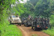 Congolese army soldiers and United Nations peacekeepers patrol the area of an attack near the town of Oicha