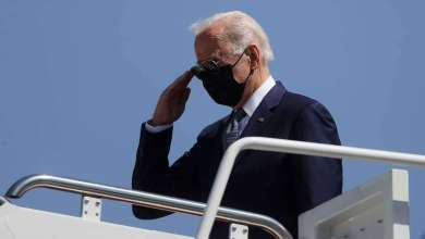 U.S. President Joe Biden salutes before boarding Air Force One to travel to Louisiana to tour the hurricane-affected areas